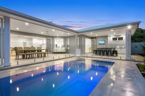 Relaxing view of a pool and lounge areas